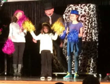 Our 3 cheer leaders on stage helping with a fun magic routine...